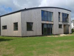 Maison bois toit cintré Finistère Trégana
